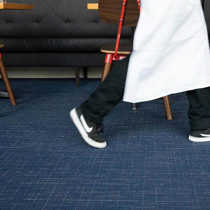 urban vibe: savile in color dark blue adds a chic touch to restaurant floors or other heavy traffic areas