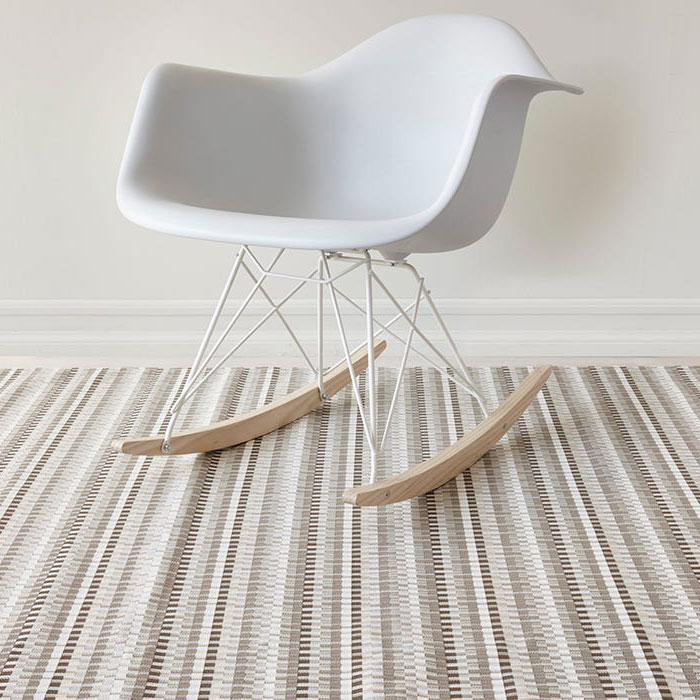 neutral shade & textural interest: heddle as an area rug under a rocking chair (in color pebble)
