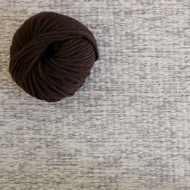 interesting textural effect: striated yarn of neutral ground comes in five earth tones; shown in ivory