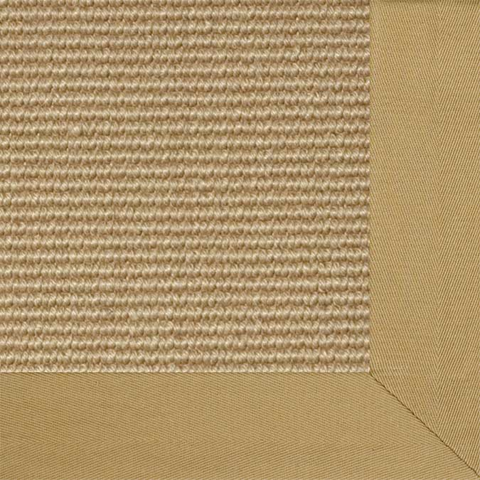 soft cotton twill binding in the color granola finishes off a tobago area rug