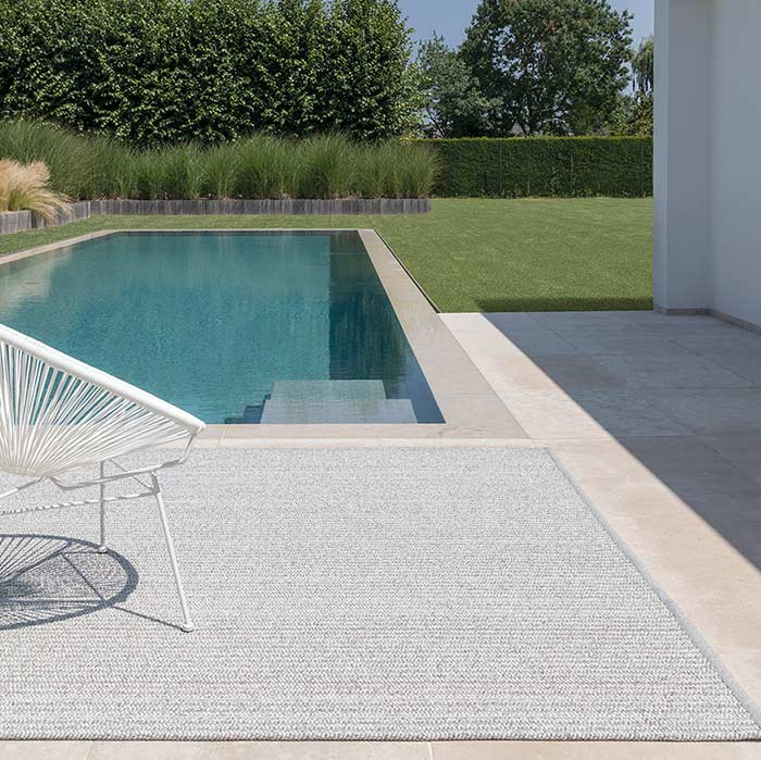 outside elegance: patio synthetic area rug in white dew
