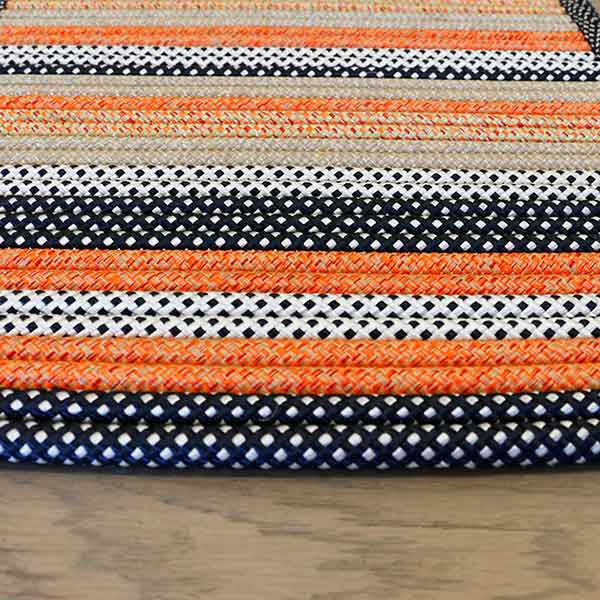 a custom pattern of black, orange, white, and tan rope