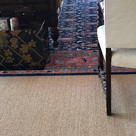layered beauty: stockholm sisal layered with a wool rug creates a well-dressed room (color spring)