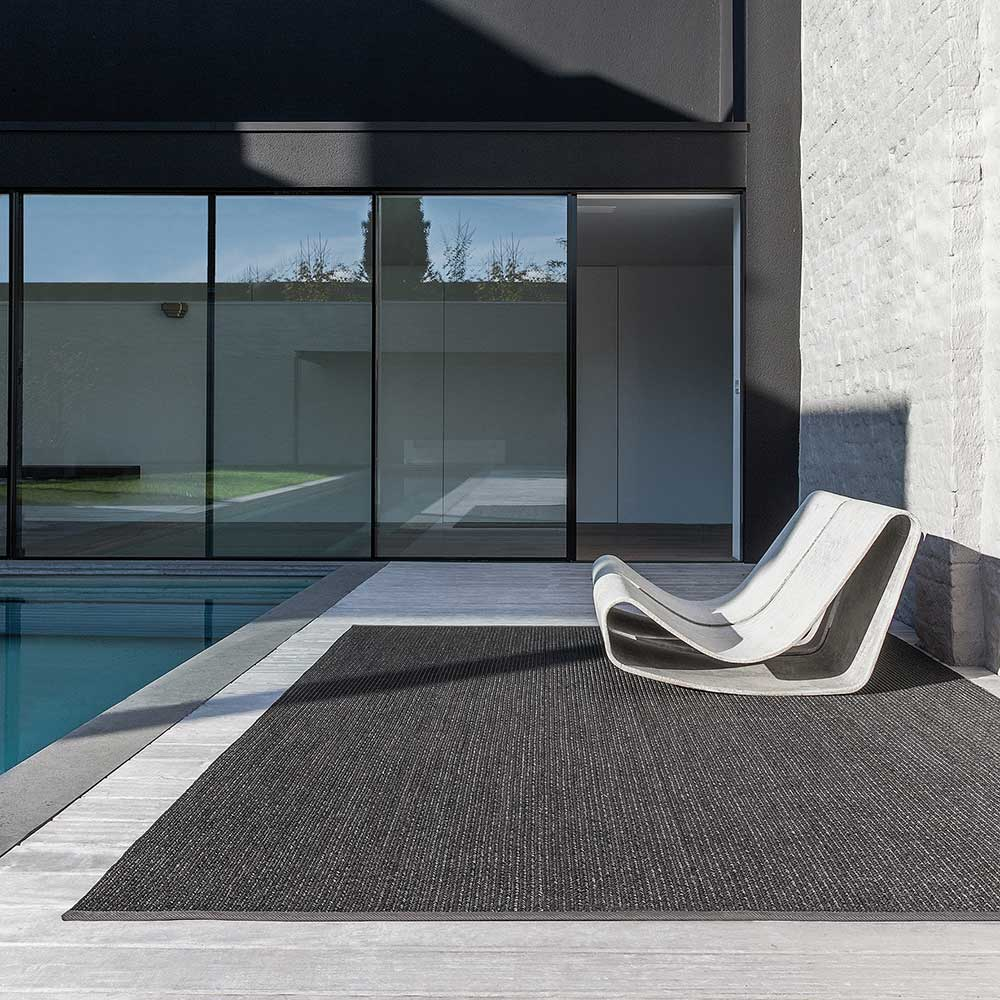 poolside area rug w/ matching binding on the two widths sides (black ink)