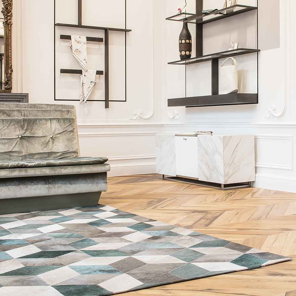 whimsy & sophistication: cubic's geometric pattern create a focal point (custom leather rug in color bayou)